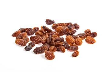 brown raisins on a white background
