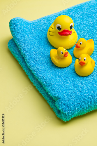 yellow bath duck on blue towel