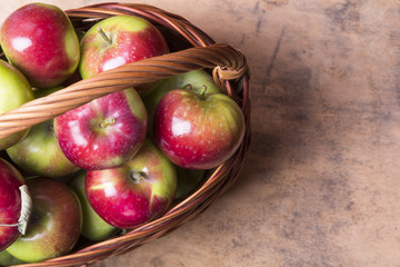 apples in a wicker basket, top view