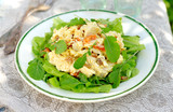 Chicken salad with dried fruit and fresh greens