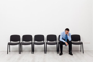 Desperate businessman or employee sitting alone