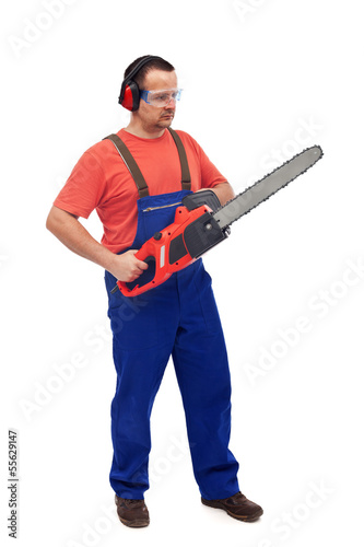 Worker with chainsaw