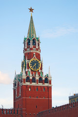 Moscow Kremlin, Spasskaya clock tower. Blue sky background.