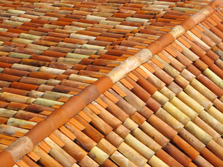 Roof tiles with ridge tiles on top made from fired clay.