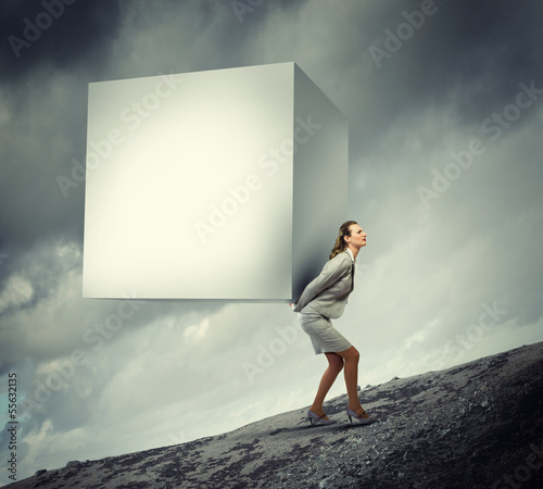 Businesswoman carrying cube