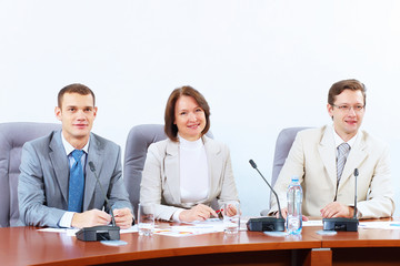 Three businesspeople at meeting