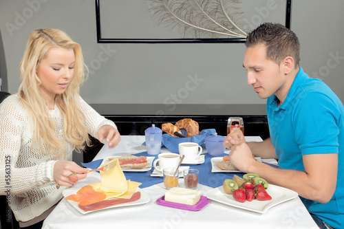 Attractive young couple enjoying breakfast