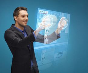 businessman pressing buttons on virtual screen