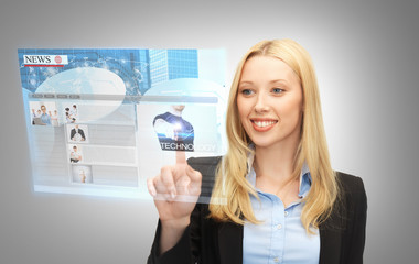 businesswoman pressing buttons on virtual screen