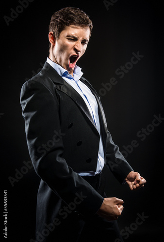 Opera singer performing over black background