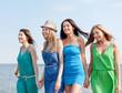 girls walking on the beach