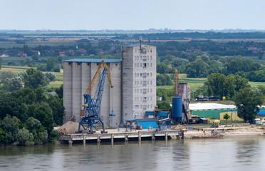Grain silos next to river