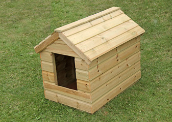 A Brand New Wooden Dog Kennel on a Grass Lawn.