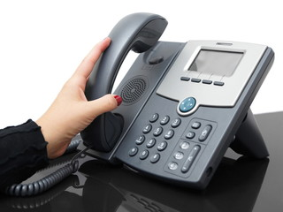 Businesswoman is answering a phone