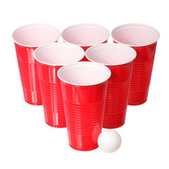 Beer pong. Red plastic cups and ping pong ball isolated