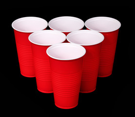 Beer pong. Red plastic cups over black