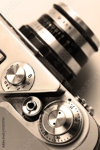 old camera. Sepia. Stylish retro background.