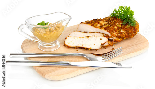 Roasted chicken fillets on wooden board, isolated on white