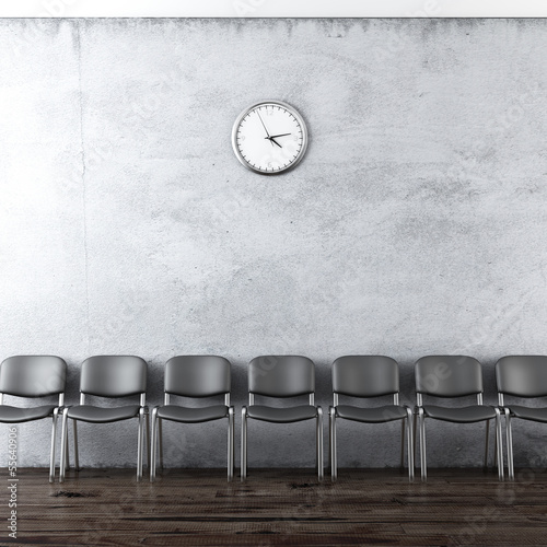 wall clock and black chairs