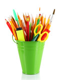 Colorful pencils and other art supplies in pail isolated