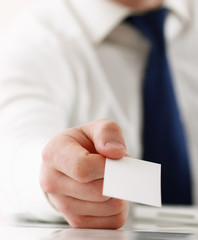 business man holding blank white business card