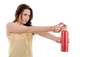 The image of young woman with extinguisher on white