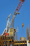 Concrete formwork and crane on construction site poster