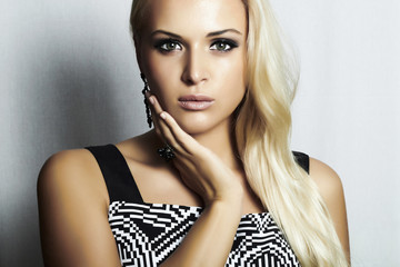 Beautiful fashion blond woman in dress.beauty girl.make-up