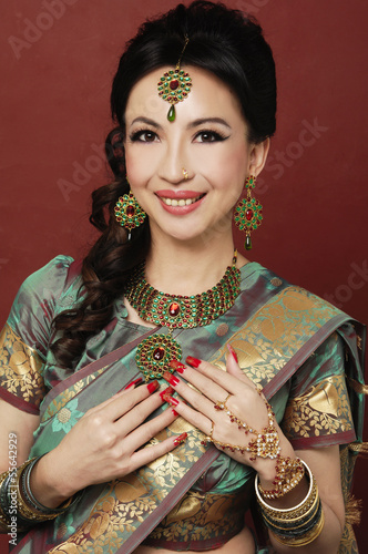 Asian beautiful woman wearing luxurious wedding dress