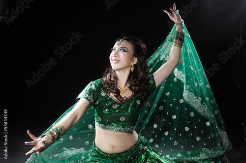 beautiful female wearing traditional indian costume posing