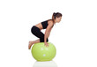 Young beautiful woman with gymnastic ball