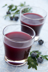 Blueberry juice in a glass.