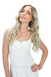 Content sensual model in white dress posing