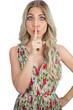 Gorgeous blond model  wearing flowered dress hiding secret