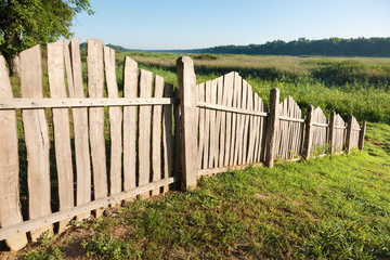 Fence on a meadow in early morning