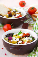 Baked vegetables with feta cheese in Greek style