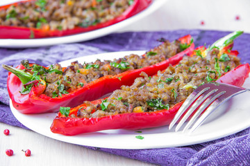 Stuffed red pepper with meat, carrot and parsley, tasty meal