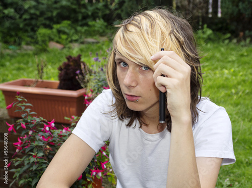 Teenage boy holding an electronic cigarette