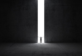 Man stands in the light of opening.