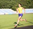 Girl running on the stadium track