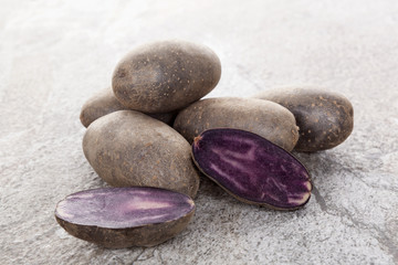 Raw purple potatoes.