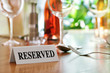 Restaurant reserved table sign
