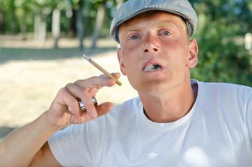 Young man enjoying a cigarette