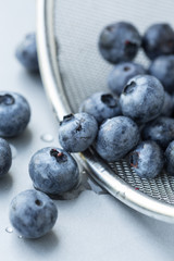 Blueberries in strainer, selective focus