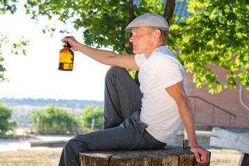 Man sitting outdoors enjoying a drink