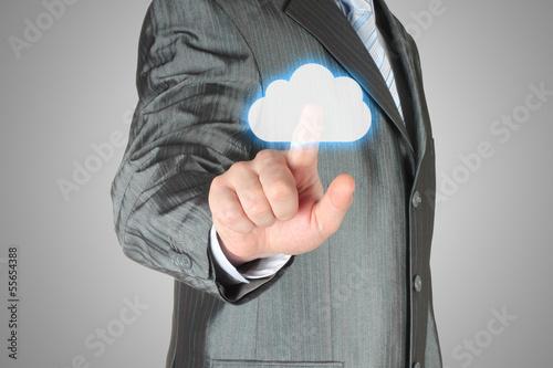 Businessman pushes virtual cloud button