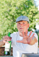 Rural drunk protesting being photographed