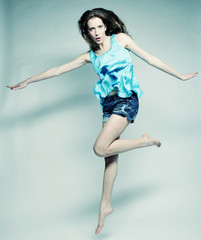 High fashion model jumps in studio
