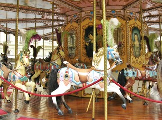 Colorful horses on a merry go round
