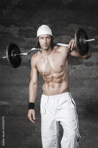 Handsome bodybuilder posing in front of the camera